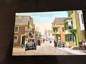This color lithograph postcard was created over 100 years ago. What's on that corner now?